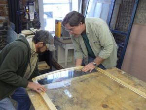 Setting curved glass into arched top wood storm window
